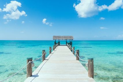 Island Pier On Perfect Tropical Beach With Blue Water red
